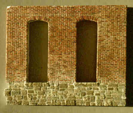 Photo of a brick and stone wall.