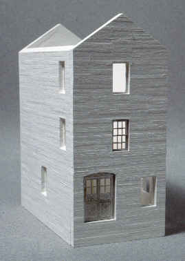 The Concrete Cream House is a tall narrow structure that will fit in nicely and add interest to any scene.