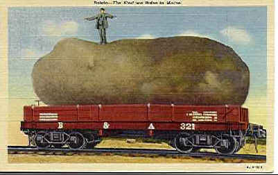 A big giant potato on a flat car.